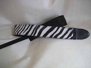 LEATHER BLACK WITH A ZEBRA FELT BASS, ACOUSTIC GUITAR STRAP