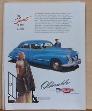 "1947 magazine ad for Oldsmobile - Style Leader, blue ""98"" four door sedan"