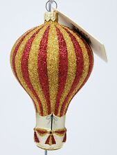 Patricia breen glass ornament: red and gold glittered balloon.