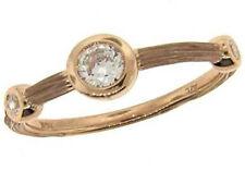0.31 ct F VS round diamond graduated journey bezel set wedding ring rose gold