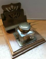 A wooden and brass ink stand and letter rack, square glass ink well