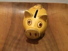 An unusual ceramic Washington DC piggy bank with tribal style decoration to side