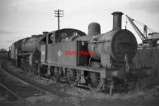 PHOTO  LMS LOCO NO 47305 AT ARNOTT YOUNG TROON IN 1966
