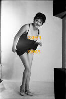 semi-nude woman smiling in home made studio, 1970s vintage fine art negative