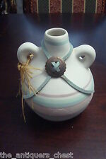 American Indian Pottery canteen with leather and medallion,  unmarked, numbered