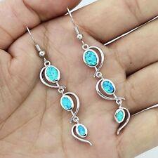 Beautiful 925 Sterling Silver Blue Fire Opal Twist Dangle Oval Stud Earrings