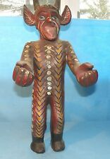 Devil figure with horns and tail, hand painted