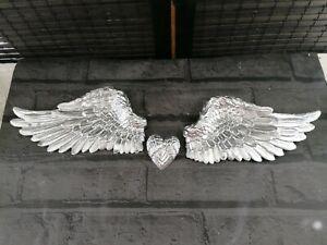 Silver angel wings wall art