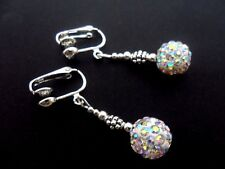 A PAIR OF DANGLY WHITE SHAMBALLA STYLE  DANGLY CLIP ON EARRINGS. NEW.