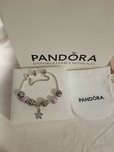Silver pandora bracelet with pink flower charms.