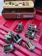 7 (Seven) Vintage fishing reels and tackle box