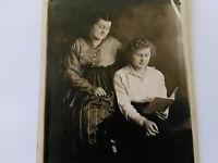 Vintage rppc photo antique fine delux image two women poignant reading what?
