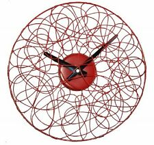 RED AND BLACK METAL WIRE VORTEX/FAN WALL CLOCK NEW AND BOXED.