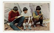 ESKIMO BOYS CARVING IVORY: Alaska USA postcard (JH2061)