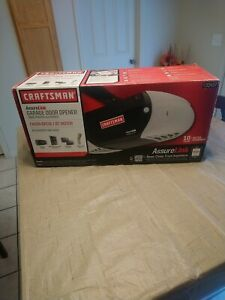Craftsman 3/4 HP Garage Door opener w/2remotes, motion sensor,keypad entry link