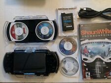 PSP Console 2001 with 4 game one movie replacement battery case charge/data cord