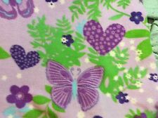 "Butterfly heart flower fleece fabric with a purple background, 60"" by 27"""