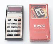 Vintage Texas Instruments TI-1200 Calculator Red LED display, boxed Excellent