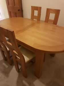 Oak extending dining table and chairs