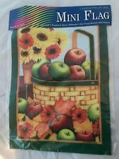 Decorative Mini Flag Flowers with a Basket of Apples