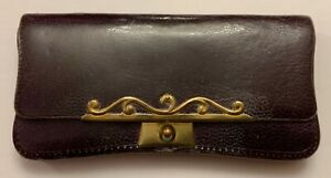 Very elegant leather and brass stamp and coin case. The interior with separate t