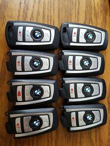 LOT OF 8 BMW SILVER SMART KEY REMOTE FOB FCC: YGOHUF5767 (4-BUTTON) GOOD!