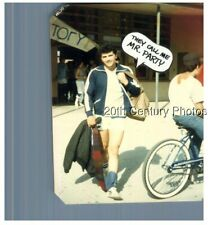 Found Color Photo F_7526 Man In Shorts By Other On Bicycle