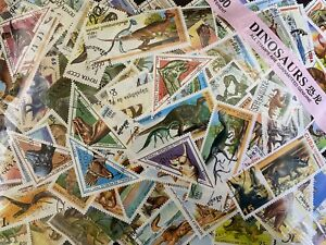 Thematic Stamp Packet -  Dinosaur on stamps 100 Difference  + Free Gift
