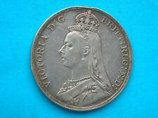 Victoria 1890 silver crown. in plastic capsule very good detail. edge knock