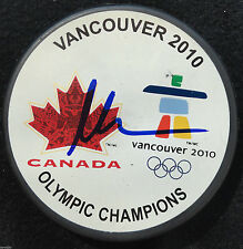 MARTIN BRODEUR SIGNED VANCOUVER 2010 OLYMPICS HOCKEY PUCK DEVILS CANADA PROOF J6