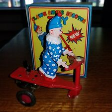 CLOWN RIDING A SCOOTER TOY WIND UP BY BLIC CHINA, FOR COLLECTORS (2d)
