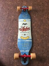 Wooden arbor longboard with red trucks