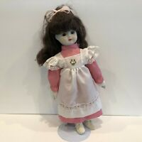 "16"" Vintage Porcelain Female Doll with Brunette Hair and Pink Dress"