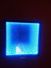 Infinity Mirror with color changing LEDs and 24 key wireless remote.