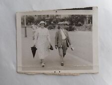 1930s B/W Photograph. Mature Man & Woman Walking in the Street. Clothing/ Style