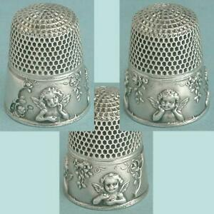 Antique Sterling Silver Seated Cherubs or Angels Thimble by KMD * Circa 1890s