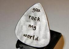 Guitar pick with you rock my world in lowercase