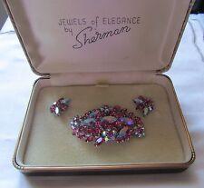 Vintage silver tone Sherman brooch and earrings set with pink rhinestones