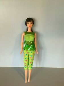 Teresa - Hispanic friend of Barbie; tnt; brunette; brown eyes; green outfit