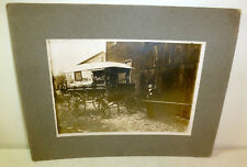 Antique photo old man and black carriage near barn, c. 1890