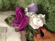 purple themed wedding boutonierre for parents