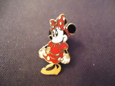 DISNEY MINNIE MOUSE STANDING WITH A RED AND WHITE POLKA DOTTED DRESS PIN