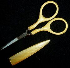 ANTIQUE SEWING SCISSORS, GUILLOCHE, SILVER, STEEL & YELLOW ENAMEL WITH HOLDER