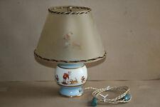 Lampe base en porcelaine, décor d'enfants  Marque au Serpent