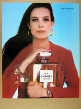 1987 Chanel No.5 Perfume woman holding large bottle photo vintage print Ad