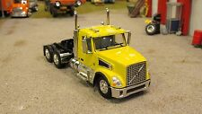 LOOSE BRIGHT YELLOW DCP VOLVO VT800 OWNER OPERATOR SEMI DAY CAB TRUCK 1:64/