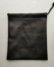 Black fabric bag with draw string has an impressed Creative name internal pocket