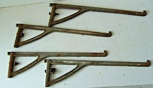 Four (4) Vintage Cast Iron Glass Store Shelf Brackets