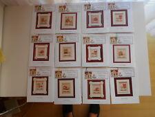 Point de croix jeu de Modèles Santa's village de Country Cottage Needlework, 12 maisons