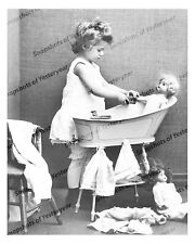 1900s era vintage photo-Little girl giving her dolly a bath-baby-doll-8x10 in